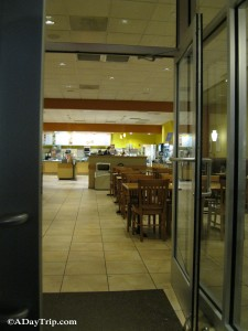 An inside view of Au Bon Pain and its seating area and shop.