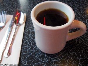 Coffee in the mug on a 50's style table at Dave's Diner